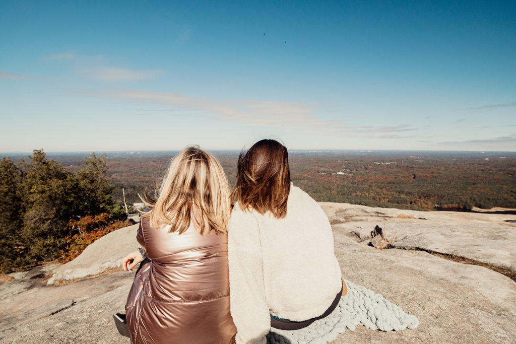 48 hours in Atlanta Guide: Sitting at the top of Stone Mountain looking at the view