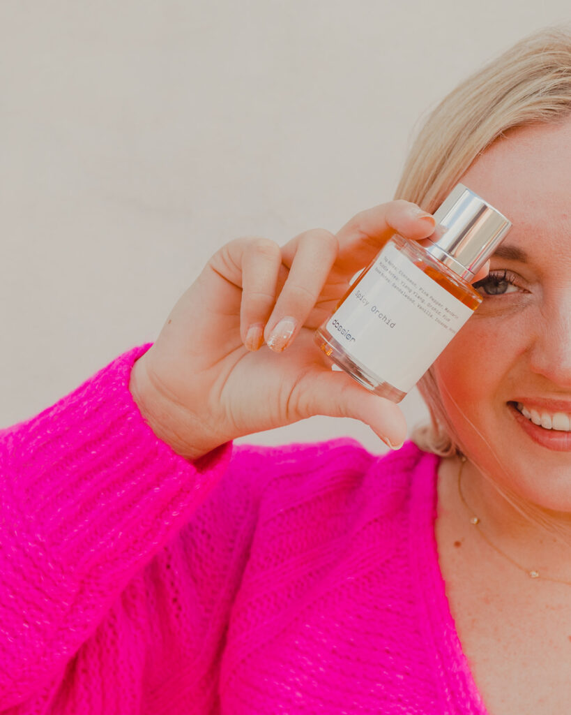 Gift Ideas for Valentine's Day - Woman holding bottle of perfume from Dossier