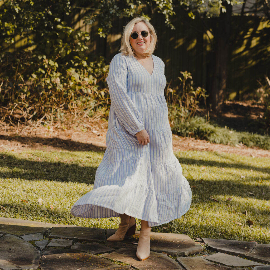 Spring Dresses from Target - Woman standing outside twirling in a long sleeve v neck tiered maxi dress, wearing sunglasses