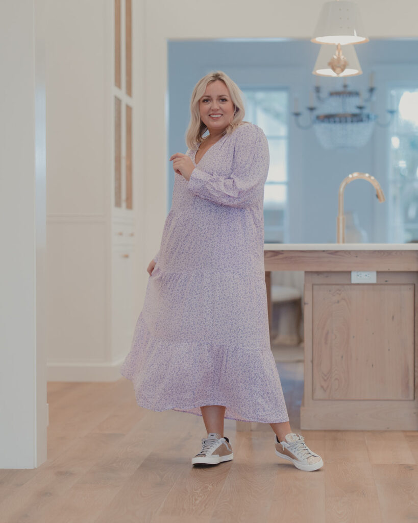 Spring Dresses from Target - woman standing in kitchen wearing a tiered maxi dress with sneakers