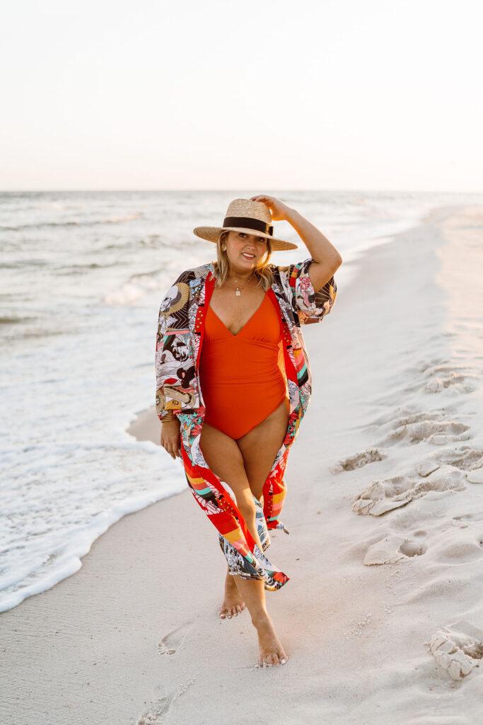 5 Ways to Style a Kimono - Woman standing on beach wearing Amazon one piece bathing suit with Kimono from Amazon