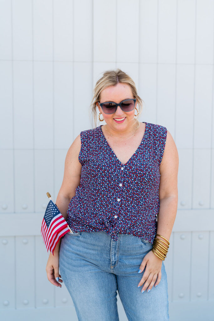 What to Wear 4th of July - Dainty red, white and blue star covered v-neck sleeveless shirts with denim jeans
