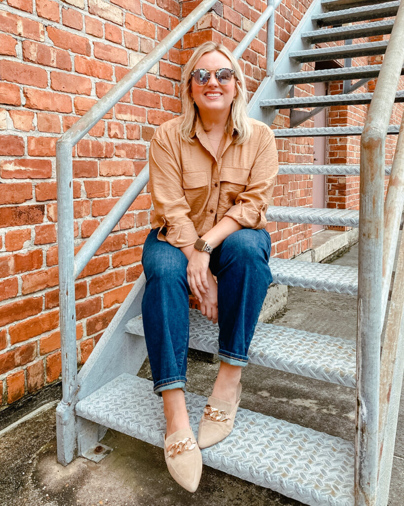 Woman sitting wearing long sleeve button up utility shirt with denim jeans from Banana Republic Fall Styles. SellEatLove.com