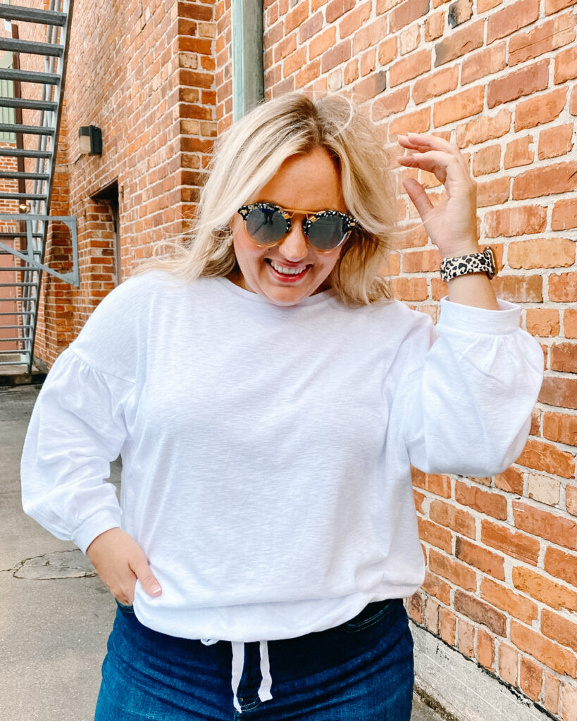 Woman wearing white long sleeve top and Denim Jeans from Banana Republic. SellEatLove.com