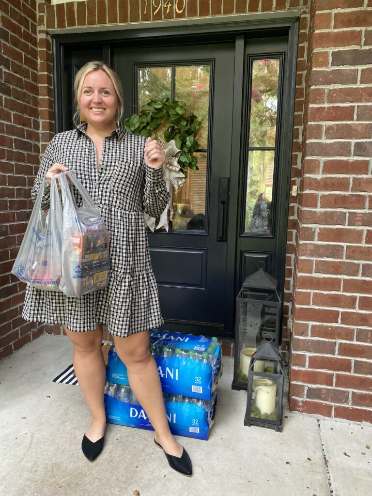 Why I got a Walmart+ Membership. Woman standing on front porch with Walmart + Delivery. SellEatLove.com